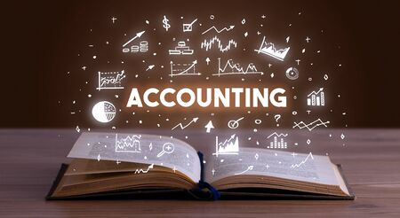 ACCOUNTING inscription coming out from an open book, business concept 写真素材