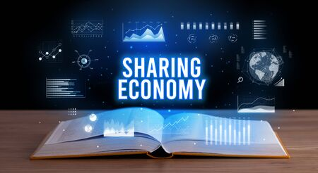 SHARING ECONOMY inscription coming out from an open book, creative business concept