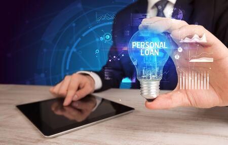 Businessman holding lightbulb with PERSONAL LOAN inscription, Business idea concept