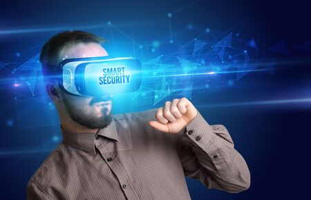 Businessman looking through Virtual Reality glasses with SMART SECURITY inscription, cyber security concept Foto de archivo