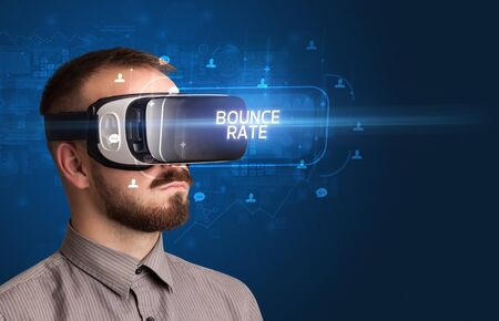 Businessman looking through Virtual Reality glasses with BOUNCE RATE inscription, social networking concept