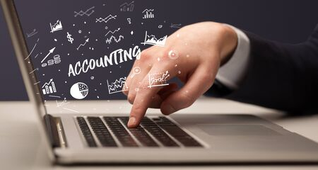 Businessman working on laptop with ACCOUNTING inscription, modern business concept