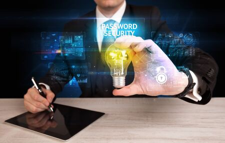 Businessman holding lightbulb with PASSWORD SECURITY inscription, online security idea concept