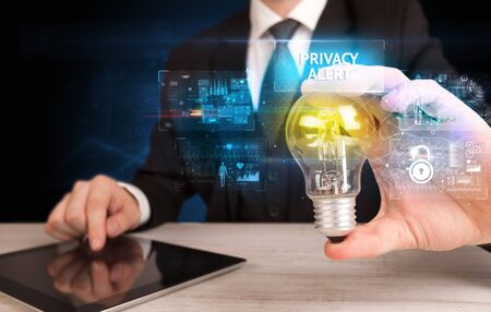 Businessman holding lightbulb with PRIVACY ALERT inscription, online security idea concept 스톡 콘텐츠 - 140004613