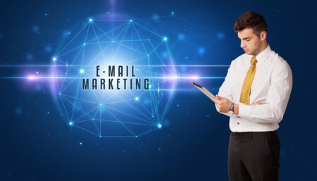 Businessman thinking about security solutions with E-MAIL MARKETING inscription