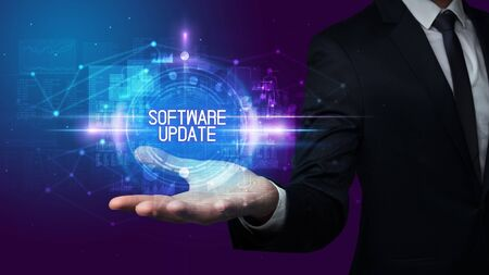 Man hand holding SOFTWARE UPDATE inscription, technology concept