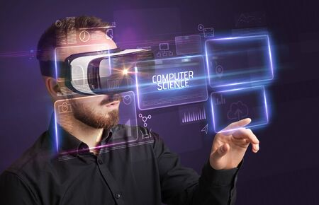 Businessman looking through Virtual Reality glasses with COMPUTER SCIENCE inscription, new technology concept