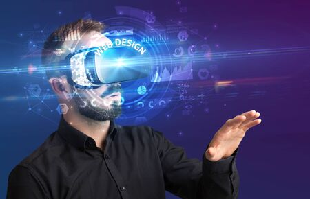 Businessman looking through Virtual Reality glasses with WEB DESIGN inscription, innovative technology concept