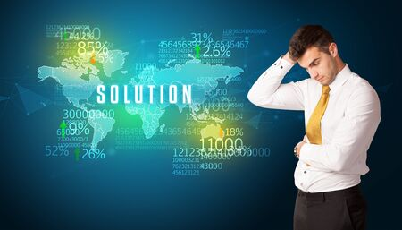 Businessman in front of a decision with SOLUTION inscription, business concept