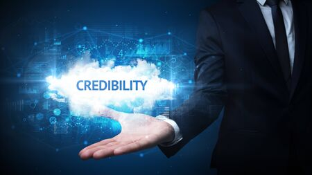 Hand of Businessman holding CREDIBILITY inscription, successful business concept