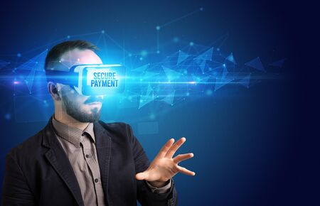 Businessman looking through Virtual Reality glasses with SECURE PAYMENT inscription, cyber security concept Foto de archivo