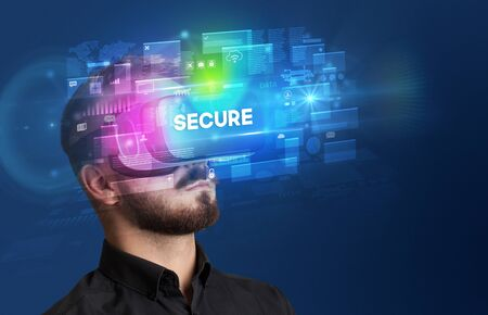 Businessman looking through Virtual Reality glasses with SECURE inscription, innovative security concept