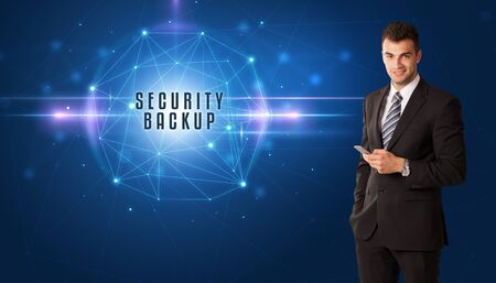 Businessman thinking about security solutions with SECURITY BACKUP inscription
