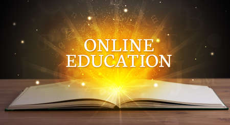 ONLINE EDUCATION inscription coming out from an open book, educational concept