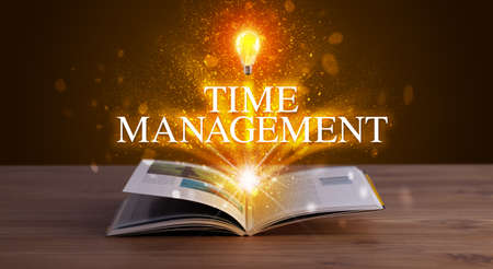 TIME MANAGEMENT inscription coming out from an open book, educational concept