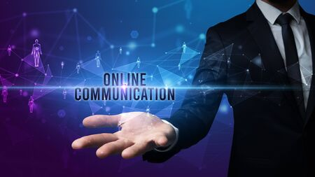 Elegant hand holding ONLINE COMMUNICATION inscription, social networking concept