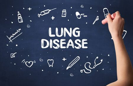 Hand drawing LUNG DISEASE inscription with white chalk on blackboard, medical concept