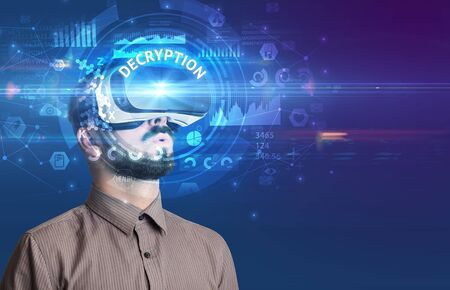 Businessman looking through Virtual Reality glasses with DECRYPTION inscription, innovative technology concept