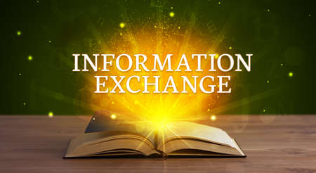 INFORMATION EXCHANGE inscription coming out from an open book, educational concept Foto de archivo