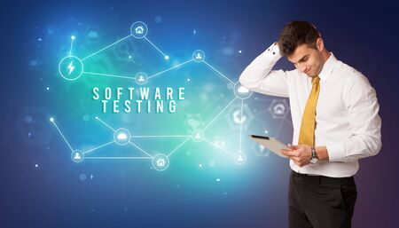 Businessman in front of cloud service icons with SOFTWARE TESTING inscription, modern technology concept