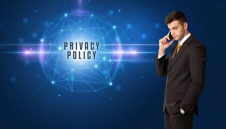 Businessman thinking about security solutions with PRIVACY POLICY inscription