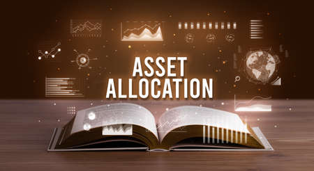 ASSET ALLOCATION inscription coming out from an open book, creative business concept Foto de archivo