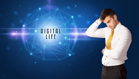 Businessman thinking about security solutions with DIGITAL LIFE inscription 版權商用圖片