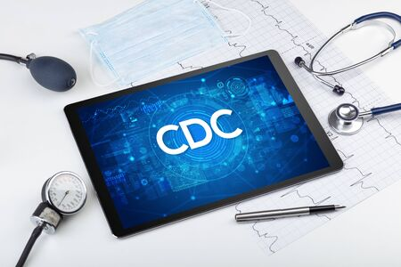 Close-up view of a tablet pc with CDC abbreviation, medical concept