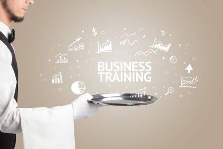Waiter serving business idea concept with BUSINESS TRAINING inscription