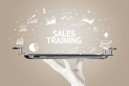 Waiter serving business idea concept with SALES TRAINING inscription
