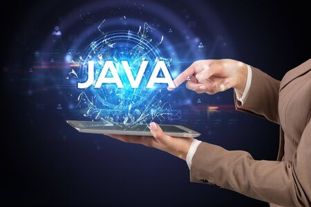 Close-up of a touchscreen with JAVA abbreviation, modern technology concept 版權商用圖片