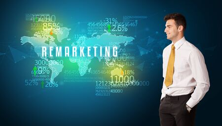 Businessman in front of a decision with REMARKETING inscription, business concept