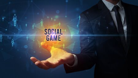 Elegant hand holding SOCIAL GAME inscription, social networking concept