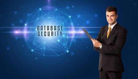 Businessman thinking about security solutions with DATABASE SECURITY inscription