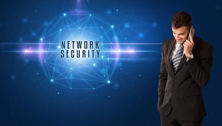Businessman thinking about security solutions with NETWORK SECURITY inscription
