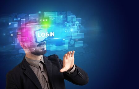 Businessman looking through Virtual Reality glasses with LOGIN inscription, innovative security concept