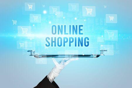Waiter serving ONLINE SHOPPING inscription, online shopping concept 免版税图像