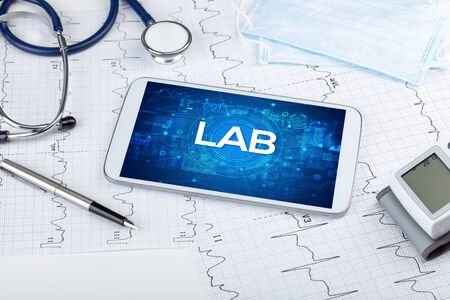 Close-up view of a tablet pc with LAB abbreviation, medical concept