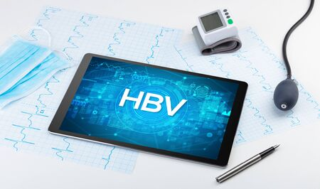 Close-up view of a tablet pc with HBV abbreviation, medical concept