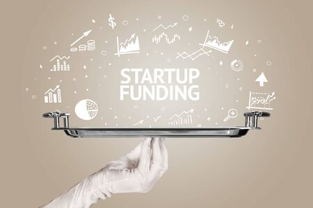 Waiter serving business idea concept with STARTUP FUNDING inscription