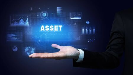 Hand of Businessman holding ASSET inscription, business success concept