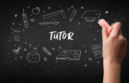 Hand drawing  TUTOR  inscription with white chalk on blackboard, education concept