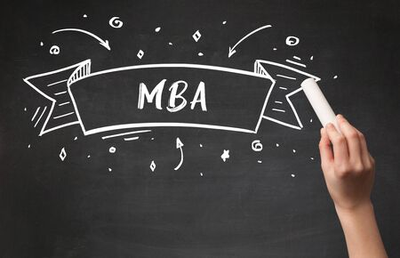 Hand drawing  MBA  abbreviation with white chalk on blackboard Banco de Imagens