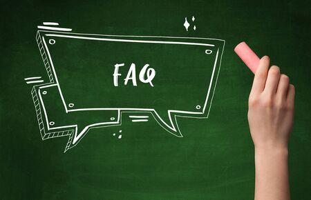 Hand drawing  FAQ  abbreviation with white chalk on blackboard Banco de Imagens