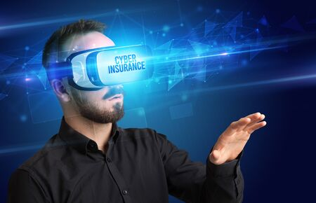 Businessman looking through Virtual Reality glasses with CYBER INSURANCE inscription, cyber security concept