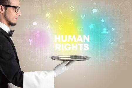 Waiter serving social networking with HUMAN RIGHTS inscription, new media concept