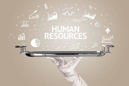 Waiter serving business idea concept with HUMAN RESOURCES inscription