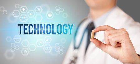 Close-up of a doctor giving you a pill with TECHNOLOGY inscription, medical concept