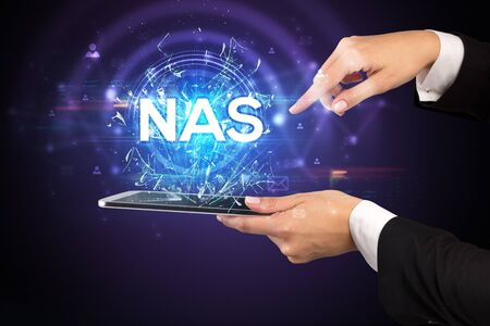 Close-up of a touchscreen with NAS  abbreviation, modern technology concept