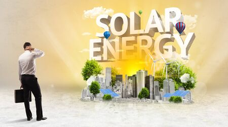 Rear view of a businessman standing in front of SOLAR ENERGY inscription, Environmental protection concept